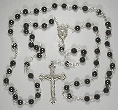 Image of Wire-wrapped 8-mm Garnet Rosary with capped Our Father Beads and click to view a larger image